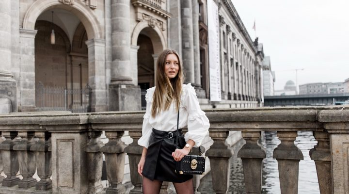 RUFFLE SHIRT, LEATHER SKIRT & COFFER BAG